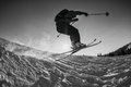 Black and white shot of free skier jumping Royalty Free Stock Photo