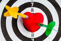 Black white target with two darts in heart love symbol as bullseye closeup of and dart red valentine skeet trap shooting sport Stock Photos