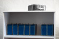 Black and white toy case with blue cases on the shelf background Royalty Free Stock Photo