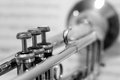 Black and White Trumpet with out of focus sheet music Royalty Free Stock Photo