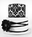 Black and white two tiered cake Royalty Free Stock Photo