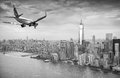 Black and white view of airplane over New York City. Tourism con Royalty Free Stock Photo