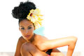Black woman, with big flowers in her hair Royalty Free Stock Photo