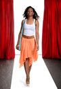 Black woman on the catwalk with red curtains Royalty Free Stock Photos