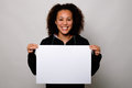 Black woman displaying white banner Royalty Free Stock Photo