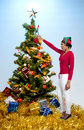Black Woman Holding a Christmas Ornament Stock Image