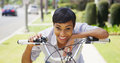 Black woman ringing bicycle bell and smiling outdoors Stock Photo
