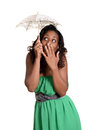 Black woman with tiny umbrella humor isolated Stock Photo