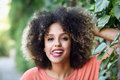 Black woman with tongue out in an urban park young mixed girl afro hairstyle funny female Stock Photo