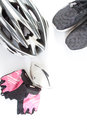 Black women's jersey eyeglasses, Pink gloves and Bicycle helmet. Royalty Free Stock Photo