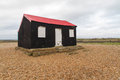Black wooden shed once used as master tardis master's in doctor who trial of a time lord the ultimate foe rye harbour kent Royalty Free Stock Photo
