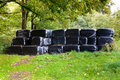 Black Wrapped Silage Cattle Fodder Bales Stock Photo