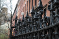 Black wrought iron fence in new york city Stock Photo