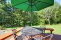 Black wrought iron patio set with open umbrella Royalty Free Stock Photo