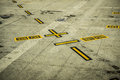 Black and yellow airport markings on concrete a picture of Royalty Free Stock Photo