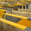 Black and yellow concrete road barriers or road blocks expressing endless concept Stock Photos