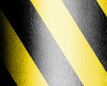Black and yellow hazard lines with grunge effects Royalty Free Stock Photos