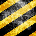 Black and yellow hazard lines with grunge effects Stock Photos