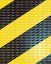 Black and yellow hazard lines with grunge effects Stock Image