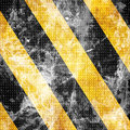 Black and yellow hazard lines with grunge effects Stock Images