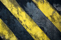 Black and yellow strips old on the wall Stock Photography