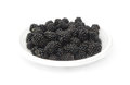 Blackberries are on a plate. Royalty Free Stock Image
