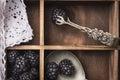 Blackberries vintage kitchen tongs white napkin in old wooden box Stock Photos