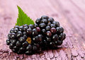 Blackberry fruit with leaf on old wood background Royalty Free Stock Photography