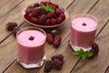 Blackberry milkshake freshly prepared in two glasses selective focus focus on the on the first Stock Photo