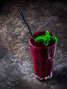 Blackberry smoothie on dark stone  background. Selective focus. Royalty Free Stock Photo