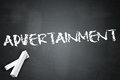 Blackboard advertainment with related wording Royalty Free Stock Images