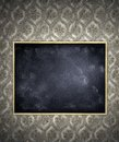 Blackboard blank on wallpaper wall Royalty Free Stock Image