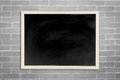 The blackboard, chalkboard with wooden frame on old brick white wall Royalty Free Stock Photo