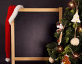 Blackboard with Christmas Tree and Santa hat Royalty Free Stock Photo