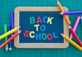 Blackboard with colorful crayons for the beginning of school Royalty Free Stock Image