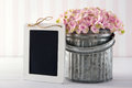 Blackboard for copy space with hydrangea flowers pink in a metal vase on vintage background empty Royalty Free Stock Photography