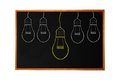 Blackboard with drawing light bulb closeup Stock Image