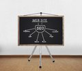 Blackboard with drawing seo scheme on tripod standing in office Royalty Free Stock Photography