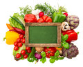 Blackboard with fresh organic vegetables and herbs