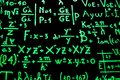 A blackboard full of mathematical equations written with phosphorescent paint to facilitate learning. Royalty Free Stock Photo