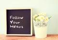 Blackboard with the phrase follow your heart written on it