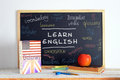 Blackboard and school material in an english class american british some books stuff for studying language a Stock Photo