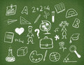Blackboard with school supplies drawn with chalk. Royalty Free Stock Photography
