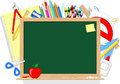 Blackboard and school supplies education items isolated on white background Stock Images