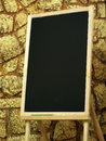 Blackboard small on stone background Royalty Free Stock Photo