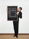 Blackboard with template web page businessman standing in office and holding Royalty Free Stock Photo
