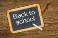 Blackboard with the text back to schoo school on a wooden table Stock Photography