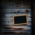 Blackboard on the wood wall Royalty Free Stock Images