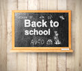Blackboard on wooden a background Stock Photos