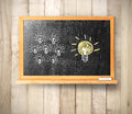 Blackboard on wooden a background Stock Images